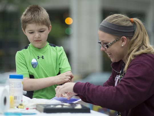 Kaiden Hensley, 8, Fishers, who is autistic, has a