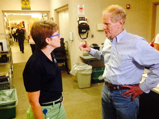 Florida Sen. Bill Nelson confers with Brevard County