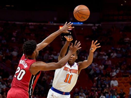 New York Knicks guard Frank Ntilikina (11) is pressured