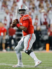 Urban Meyer is sticking with J.T. Barrett as his quarterback although calls for a change are getting louder.