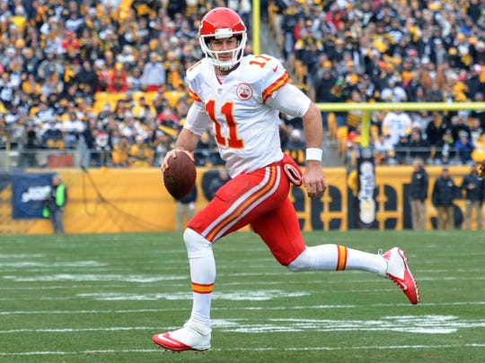 Kansas City Chiefs quarterback Alex Smith (11) scrambles out of the pocket during the first half of an NFL football game in Pittsburgh, Sunday, Dec. 21, 2014. (AP Photo/Don Wright)