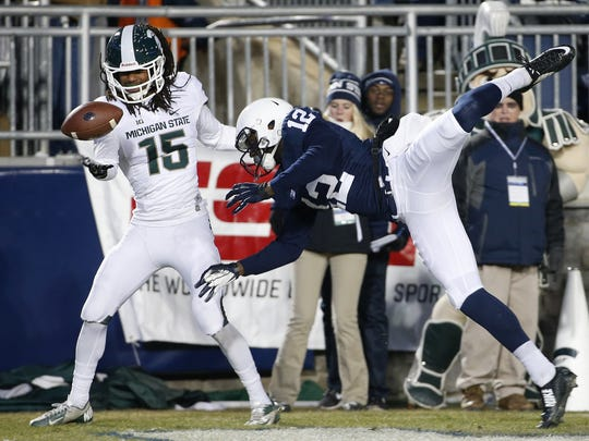 Former Michigan State cornerback Trae Waynes, right, intercepts a pass in the end zone intended for Penn State wide receiver Chris Godwin during Michigan State's win last November. AP Michigan State cornerback Trae Waynes (15) intercepts a pass in the end zone intended for Penn State wide receiver Chris Godwin (12) near the end of the first half of the Spartans' 34-10 victory on Saturday in Beaver Stadium. Michigan State cornerback Trae Waynes (15) intercepts a pass in the end zone intended for Penn State wide receiver Chris Godwin (12) during the second half of an NCAA college football game in State College, Pa., Saturday, Nov. 29, 2014. (AP Photo/Gene J. Puskar)