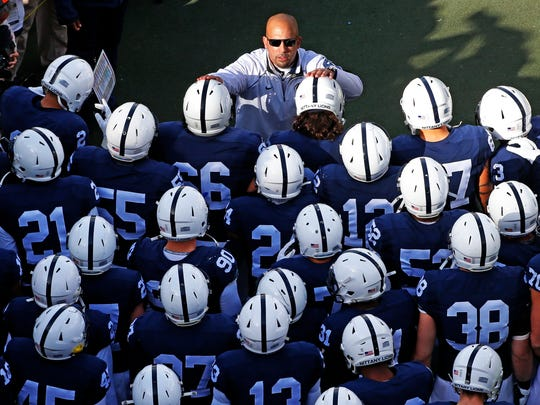 Penn State head coach James Franklin, top center, prepares to lead his team onto the field against Michigan.