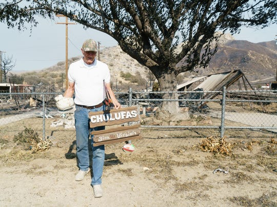Dennie Eriksen walks away from the remains of his home in South Lake, California on June 27, 2016. The Eriksen home was destroyed in the Erskine Fire, which ripped through South Lake and other towns near Lake Isabella, destroying 285 homes and burning over 48,000 acres.