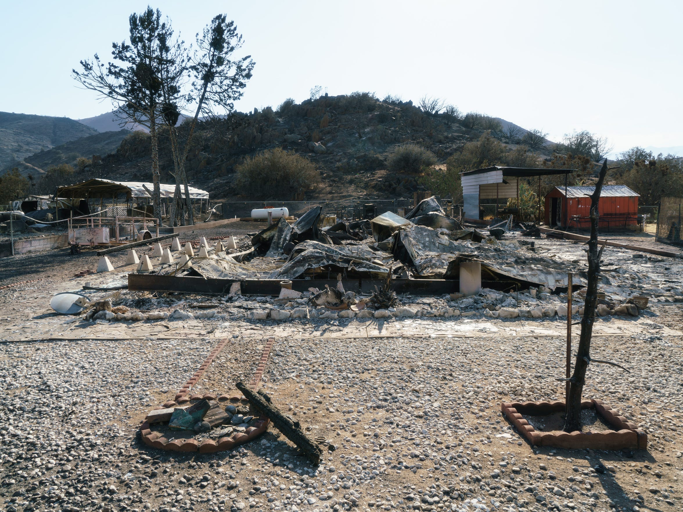 Burned remains of a home stand in South Lake, California
