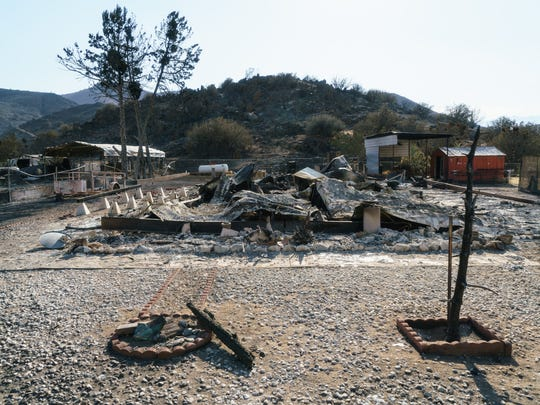 Burned remains of a home stand in South Lake, California after the Erksine Fire on June 26, 2016. The fire ripped through South Lake and other towns near Lake Isabella, destroying 285 homes and burning over 48,000 acres.