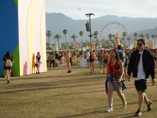 Apr 16, 2017; Indio, CA, USA; Festival goers walk by art installations during the Coachella Valley Music and Arts Festival at Empire Polo Club. Mandatory Credit: Zoe Meyers/The Desert Sun via USA TODAY NETWORK