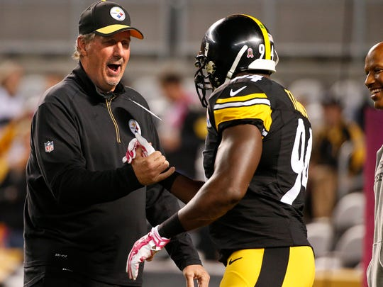 Injured Pittsburgh Steelers inside linebacker Ryan Shazier, right, watches as Steelers defensive coordinator Keith Butler, left, and Pittsburgh Steelers inside linebacker Lawrence Timmons (94) prepare for an NFL football game against the Baltimore Ravens, Thursday, Oct. 1, 2015 in Pittsburgh. (AP Photo/Gene J. Puskar)