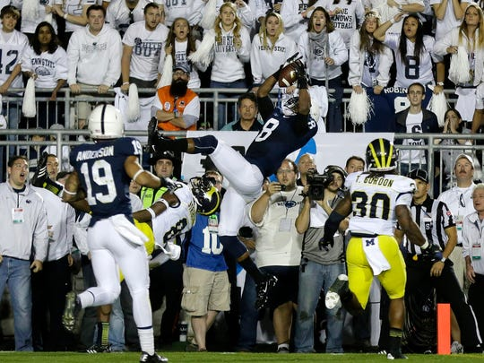 Penn State's Allen Robinson makes one of the most memorable catches in Penn State history to help the Lions tie Michigan during a white out game in 2013. The Lions went on to win in four overtimes.