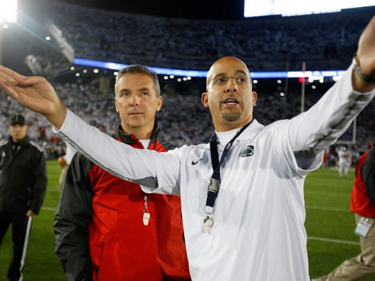 James Franklin, right, is pictured here in a file photo with former Ohio State head coach Urban Meyer. Franklin's teams were 1-4 against Meyer's teams.