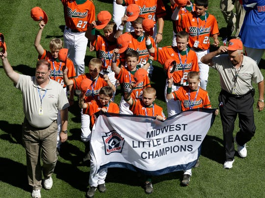 The Little League baseball team from Urbandale, Iowa, participates in the opening ceremony of the 2013 Little League World Series tournament in South Williamsport, Pa., on Thursday, Aug. 15, 2013.