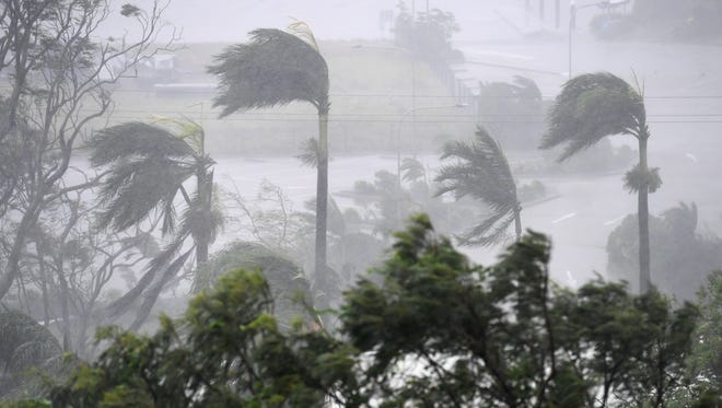 Strong winds and rain lash Airlie Beach, Australia, March 28, 2017. Reports state that Cyclone Debbie is expected to hit Queensland's far north coast as a category 4 cyclone March 28, 2017.