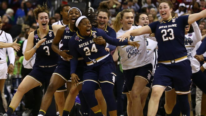 Apr 1, 2018; Columbus, OH, USA; Notre Dame Fighting Irish guard Arike Ogunbowale (24) celebrates with teammates after making the game winning basket against the Mississippi State Lady Bulldogs during the fourth quarter in the championship game of the women's Final Four in the 2018 NCAA Tournament at Nationwide Arena. Mandatory Credit: Aaron Doster-USA TODAY Sports