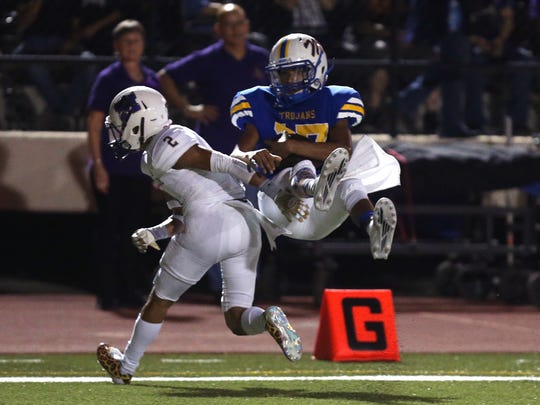 Moody Trojans' Ezekiel Moya has a completed catch to