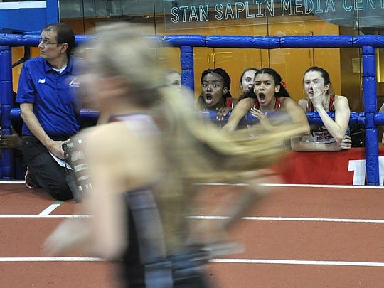 North Rockland DMR teammates Camille Cameron, Sydney March and Alex Harris scream for then-eighth-grader Katelyn Tuohy as she runs her last anchor lap during the 2016 New Balance Indoor Nationals at The Armory. The team won and set a national girls high school record at that time. North Rockland  -- this time with Haleigh Morales, Esther St. Fort, Catherine Ruffino and Tuohy -- was scheduled to attempt to win its fifth straight indoor nationals DMR title Friday but fear over spread of the coronavirus resulted in the 2020 meet being cancelled. (Photo: Nancy Haggerty)