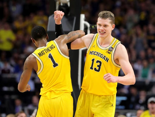Moritz Wagner, right, and Charles Matthews sparked Michigan to a second-half comeback Saturday in San Antonio.