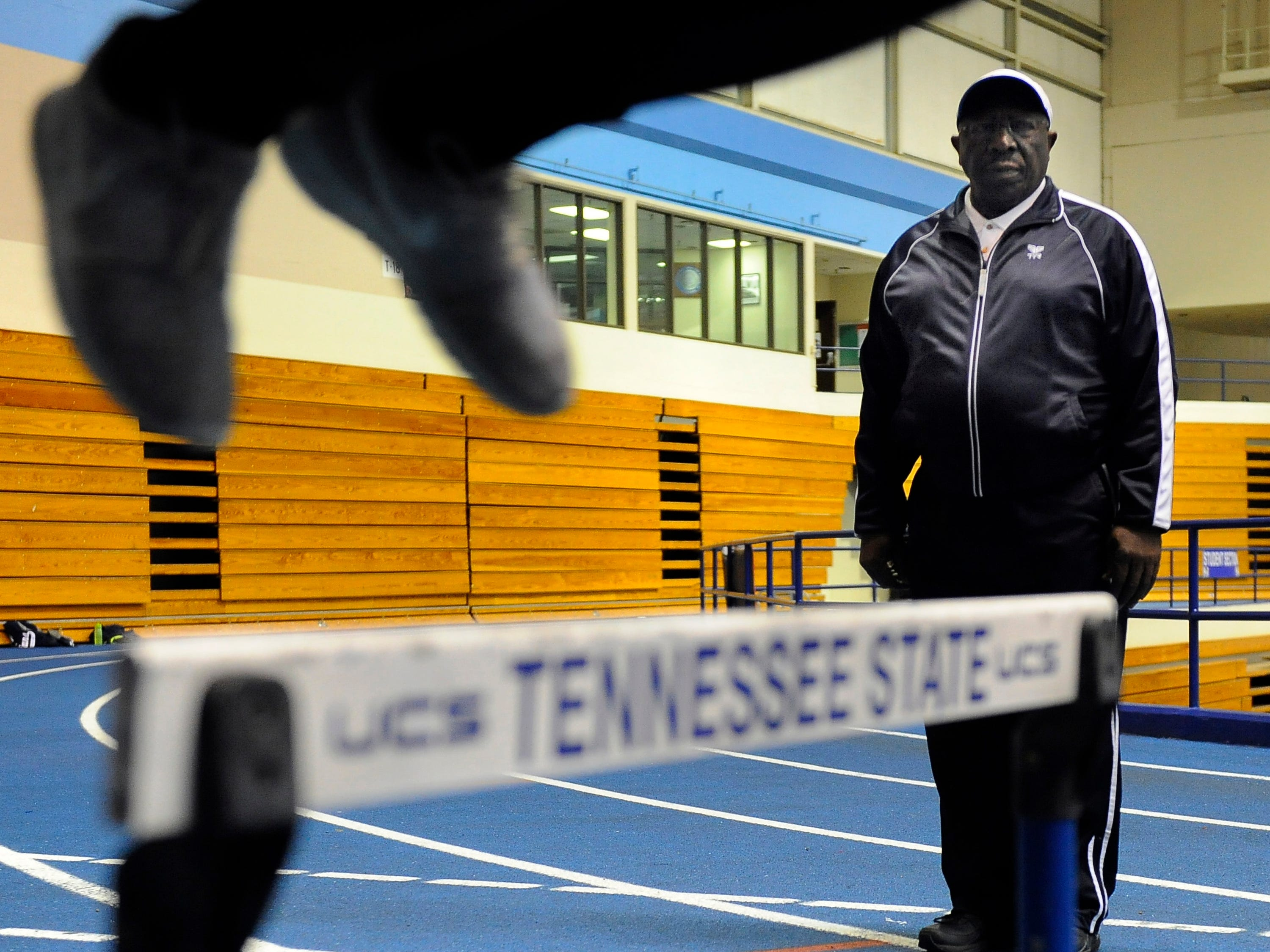 Track coach Sam Smith leads a practice with his girls track team ,the Continental T'Belles.