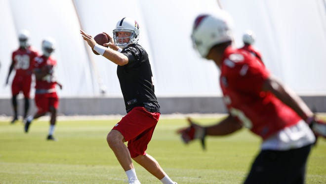 Cardinals quarterback Carson Palmer during mini camp practice on Wednesday, June 11, 2014 at the Cardinals training facility in Tempe.