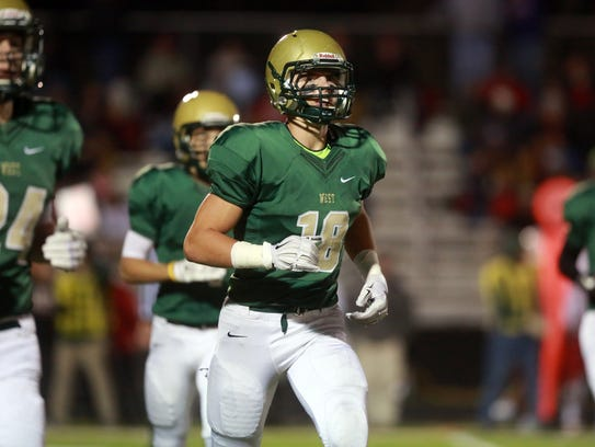 West High's Cole Mabry heads to the sideline during