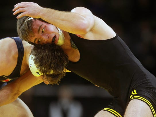 Iowa's Brandon Sorensen wrestles Illinois' Eric Barone