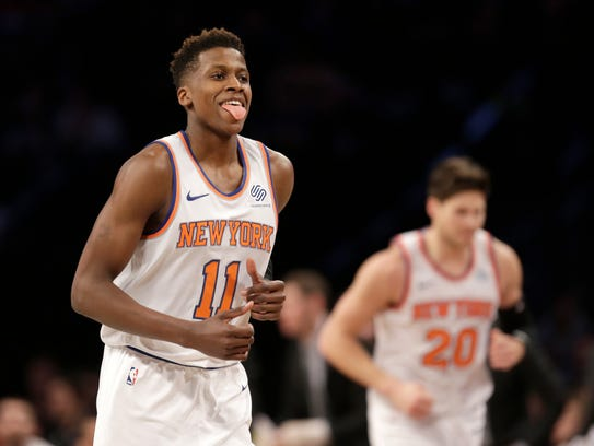 New York Knicks' Frank Ntilikina reacts after scoring.