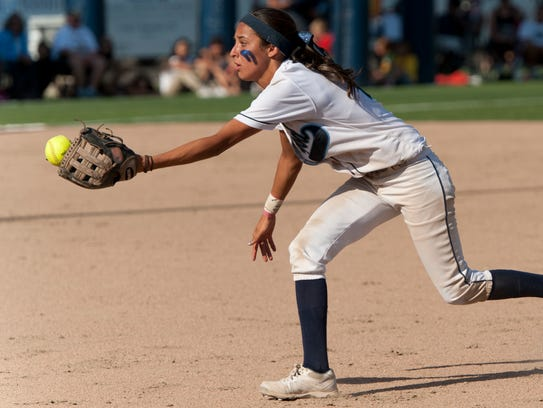 Redwood's Haileigh Gonzalez tosses to first base during
