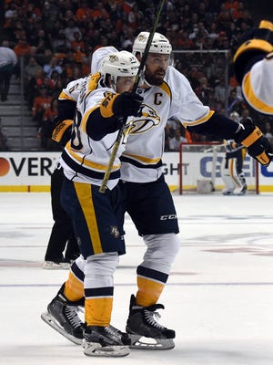 Nashville Predators defenseman Shea Weber (6) and right wing Viktor Arvidsson (38) celebrate after a goal in the first period against the Anaheim Ducks in Game 7 of the first round  on April 27, 2016.
