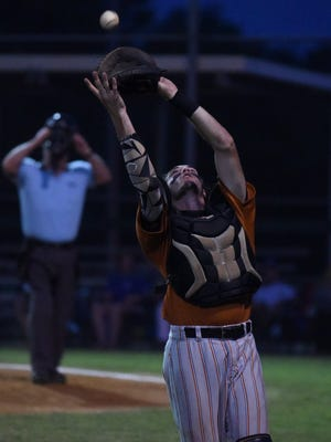 Mountain Home catcher Ben Henderson catches a fly ball during Lockeroom's 5-0 win over Harrison on Thursday in Twin Lakes Classic action at Cooper Park.