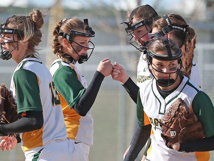Ashwaubenon High School's Tatum Tackmier fist bumps
