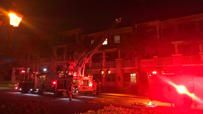 Firefighters battle fire in apartments above Citrus Grillhouse March 27, 2018.