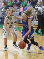 Ontario's Carleigh Pearson dribbles past Clear Fork's