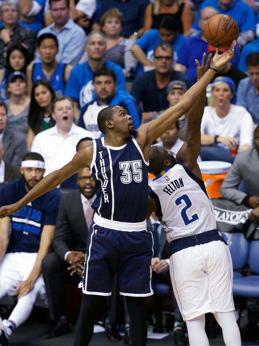 Oklahoma City Thunder forward Kevin Durant (35) reaches for the ball against Dallas Mavericks guard Raymond Felton (2) during the second half in Game 3 of a first-round NBA basketball playoff series Thursday, April 21, 2016, in Dallas. The Thunder won 131-102. (AP Photo/LM Otero)