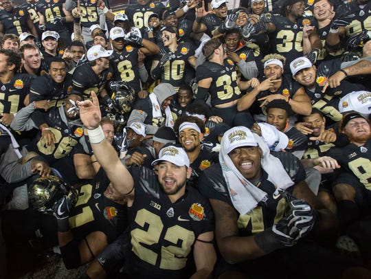 The Purdue Boilermakers celebrate after their win against