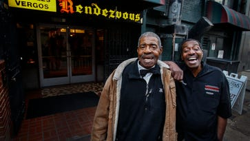 """Long-time Rendezvous waiters """"Big"""" Robert Stewart (left) and Percy Norris, who have delivered thousands of plates of barbecue to happy customers, will retire after 53 and 48 years of service. The pair who have met numerous presidents, dignitaries, and celebrates will hang up their barbecued stained uniforms for last time after this years Liberty Bowl."""