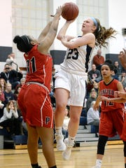 Mercy's Emily Tabone, right, is defended by Penfield's Nyara Simmons during a regular season game at Our Lady of Mercy High School on Monday, Feb. 5, 2018.