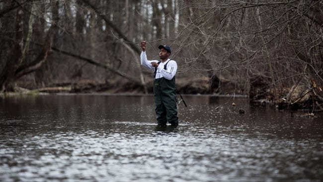 Dontez Reed, of Gettysburg, gets his line ready to cast Tuesday April 7, 2015 while trout fishing the Conewago Creek in Butler Township. Reed was trout fishing for the first time on Tuesday with his friend, Brad Thompson.