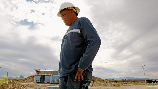 Navajo Tribal Utility Authority Foreman James Bitsilly walks through the grounds area toward the aeration basin at the utility's Wastewater Treatment Plant in Shiprock on Sept. 21, 2015.