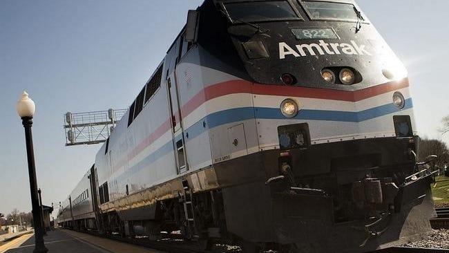 An Amtrak train passes through the Galesburg Amtrak station.