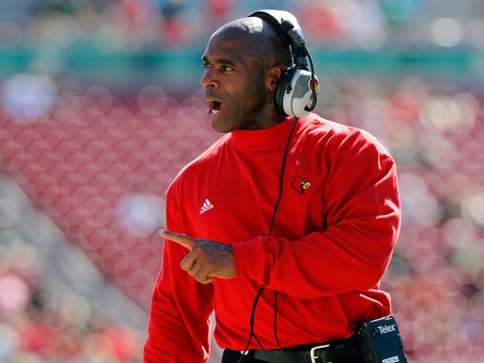 010413-charlie-strong-coaching-carousel