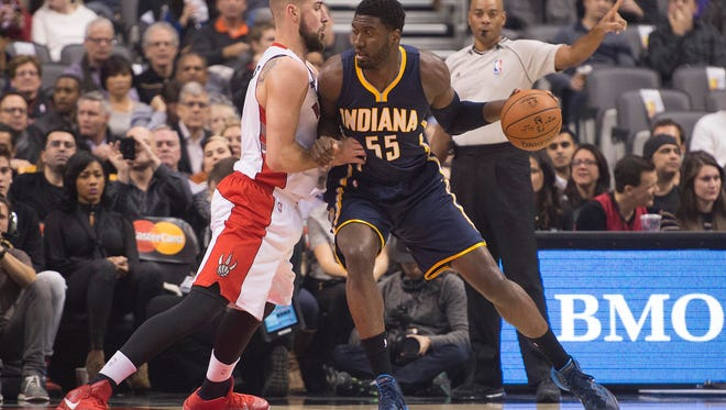 Dec 12, 2014; Toronto, Ontario, CAN; Indiana Pacers center Roy Hibbert (55) drives to the basket as Toronto Raptors center Jonas Valanciunas (17) tries to defend during the first quarter in a game at Air Canada Centre. Mandatory Credit: Nick Turchiaro-USA TODAY Sports