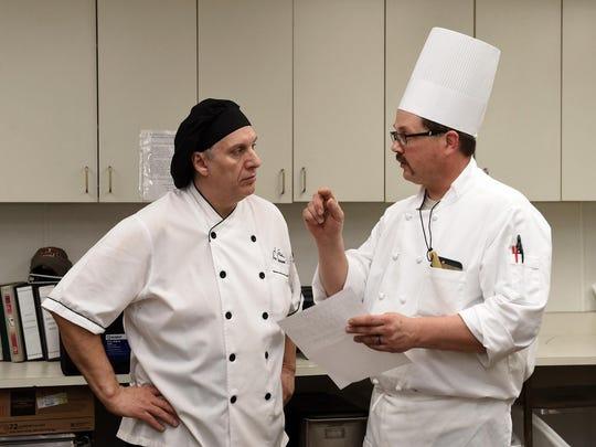 Eldorado executive chef Ivano Centemeri goes over menu items with chef Randy Wilde of Millies24 restaurant.