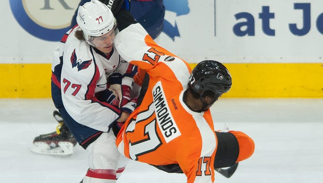 Capitals' forward TJ Oshie hits Wayne Simmonds in Washington's 6-1 win over the Flyers Monday in Game 3 of the Eastern Conference playoffs' first round.