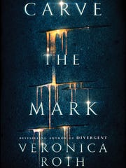"""Carve the Mark"" by Veronica Roth."