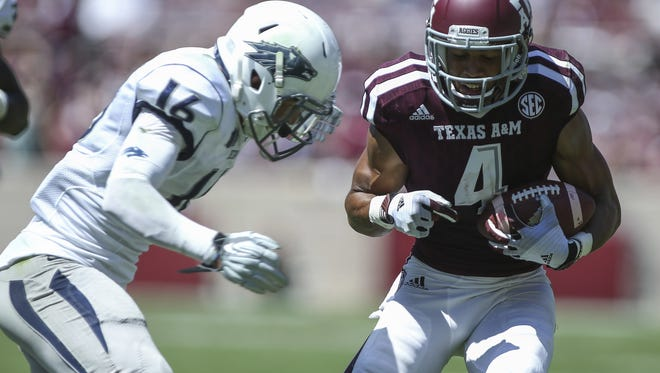 Jaden Sawyer lines up to tackle Texas A&M receiver Damion Ratley during their game in 2015. Sawyer is one of five walk-ons remaining from the 2013 recruiting class.