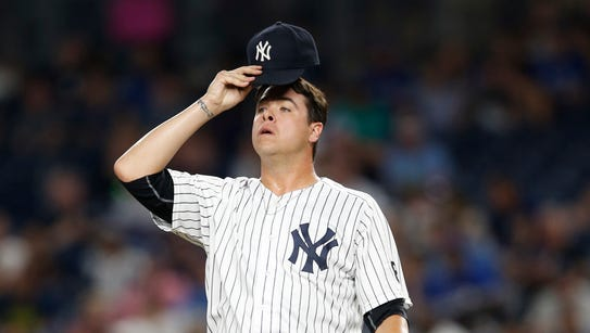 New York Yankees relief pitcher Anthony Swarzak  reacts
