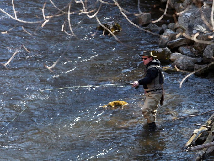Bob Weis fishes for trout along the east branch of the Croton River in Croton Falls on the opening day of trout season April 1, 2014.