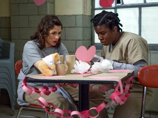 "Yael Stone, left, and Uzo Aduba in a scene from ""Orange is the New Black."""