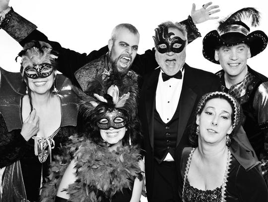 Attendees to the 2015 masquerade ball pose in their