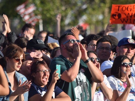 A crowd waits for Bernie Sanders to appear for a rally