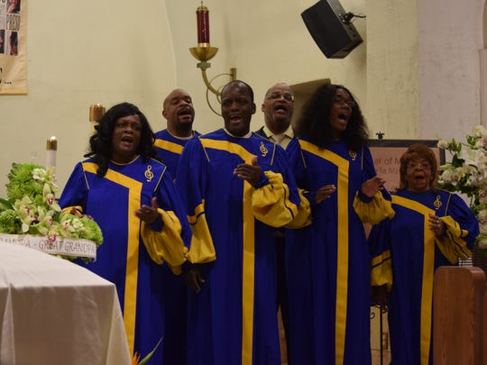 The Crenshaw Choir sings during a Catholic Mass for Ken Irwin Sr. at Our Lady of Solitude on Wednesday, July 6, 2016.